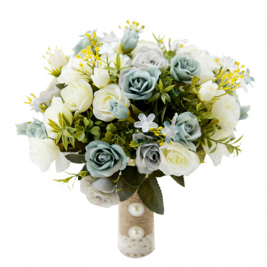 Ivory and Green folwers Bridesmaid holding flowers with green leaves