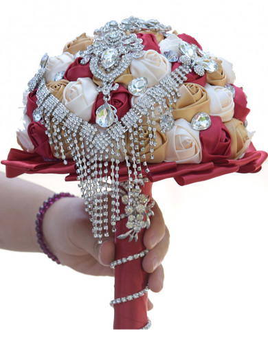 Champagne,Rose Red and ivory bride holding flowers