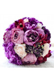 Purple artificial wedding bouquets for bride and bridesmaids holding flowers